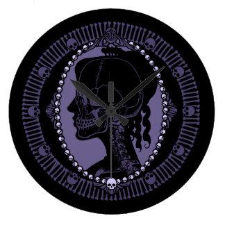 Silueta del camafeo del cráneo relojes de pared