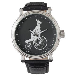 Silueta del canguro que monta una bici relojes de mano