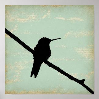 Silueta del colibrí en fondo azul del Grunge Impresiones