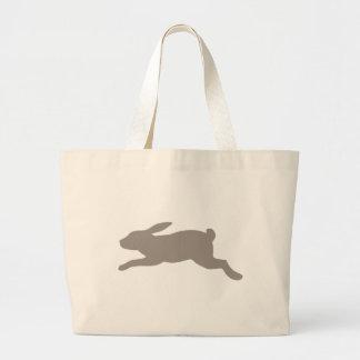 Silueta del conejo bolsas de mano