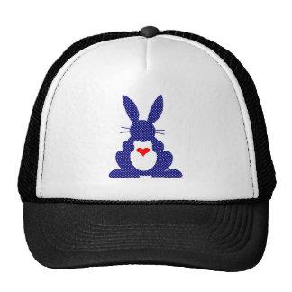 Silueta del conejo, estrellas azules del blanco gorro