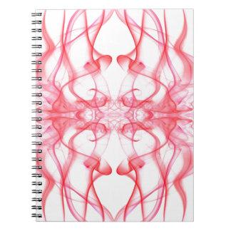 Silueta del extracto del humo coloreado rojo en bl note book