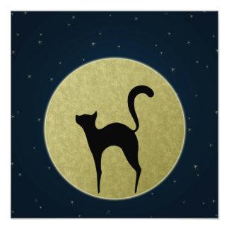 Silueta del gato e impresión de la foto de la luna