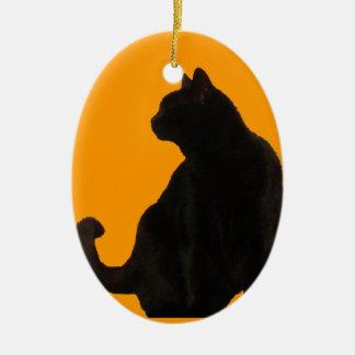 Silueta del gato negro adorno ovalado de cerámica