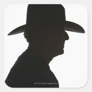 Silueta del hombre en llevar del perfil pegatina cuadrada