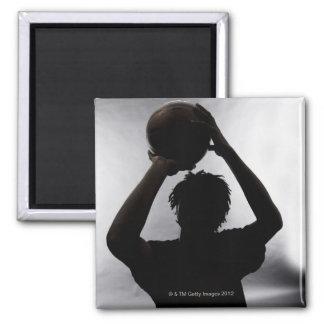 Silueta del jugador de básquet imán cuadrado