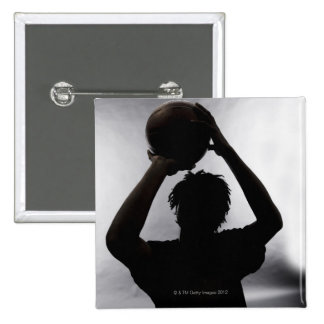 Silueta del jugador de básquet pin cuadrado