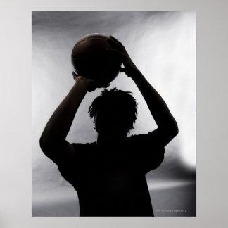 Silueta del jugador de básquet póster