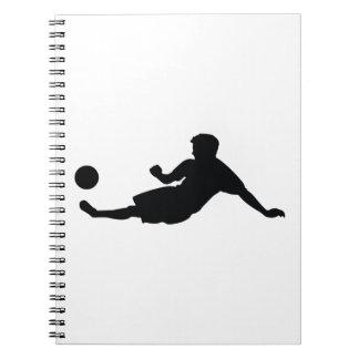 Silueta del negro del fútbol del fútbol libros de apuntes