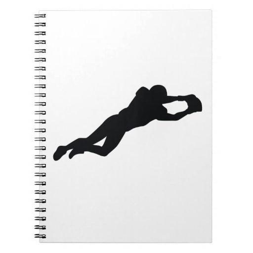 Silueta del negro del futbolista libro de apuntes