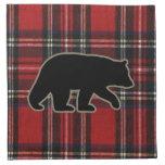 Silueta del oso negro en la tela escocesa roja servilleta