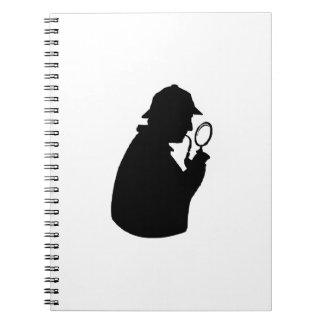 Silueta detective libretas