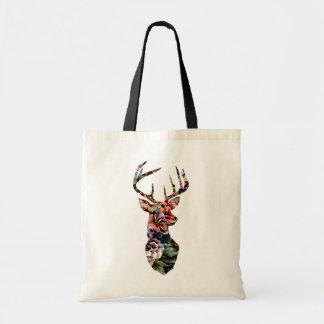 Silueta floral de la cabeza de los ciervos del bolsas