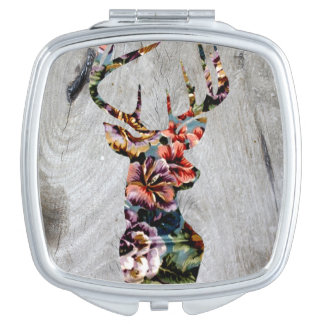 Silueta floral de la cabeza de los ciervos del espejos de maquillaje