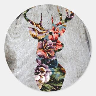 Silueta floral de la cabeza de los ciervos del pegatina redonda