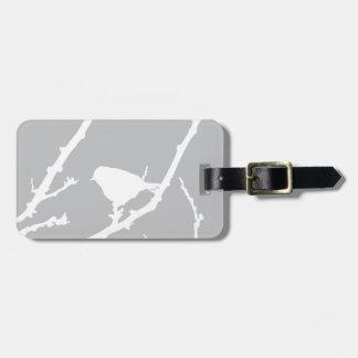 Silueta minimalista elegante del pájaro etiquetas maletas