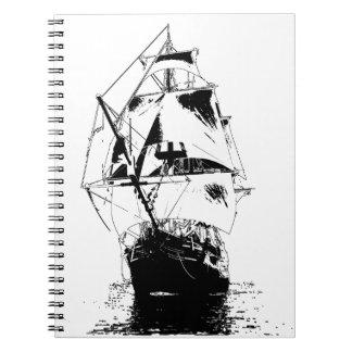 Silueta negra de la nave libro de apuntes con espiral