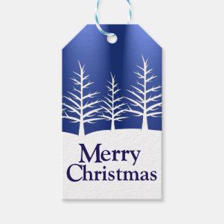 Siluetas blancas del árbol etiquetas para regalos