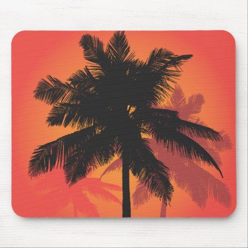 Siluetas de la puesta del sol de las palmeras tapetes de ratón