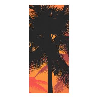 Siluetas de la puesta del sol de las palmeras lonas
