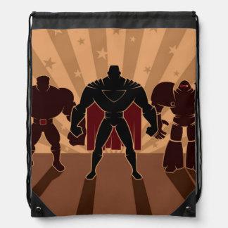 Siluetas del equipo del super héroe mochilas