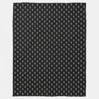 Siluetas grises del barro amasado en fondo negro manta polar
