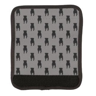Siluetas negras del barro amasado en fondo gris funda para asa de maleta
