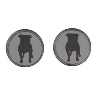 Siluetas negras del barro amasado en fondo gris gemelos plomizos
