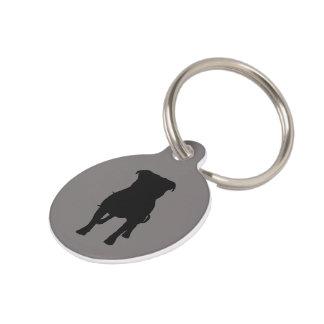 Siluetas negras del barro amasado en fondo gris identificador para mascota