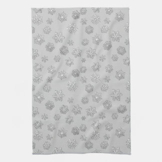 Silver 3-d snowflakes on a silver background towel