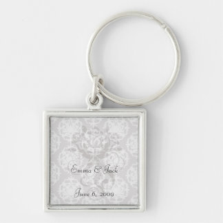 silver and white ornate damask key chains