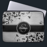 """SILVER BLACK SWIRLS YOUR MONOGRAM COMPUTER SLEEVE<br><div class=""""desc"""">Girly Silver Black Floral Swirls Personalized Laptop Sleeve. Fun, yet professional, this Personalized Silver Brushed Steel photo and Black floral swirls pattern is PRINTED ON A CLOTH laptop sleeve. Make a fashion statement with your monogram initial and name on a circular tag with a black line on a floral swirls...</div>"""