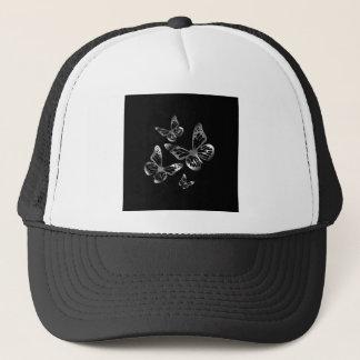 Silver colored butterflies flying trucker hat