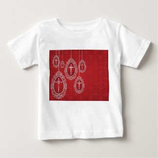 Silver crosses and filigree eggs on red tshirts