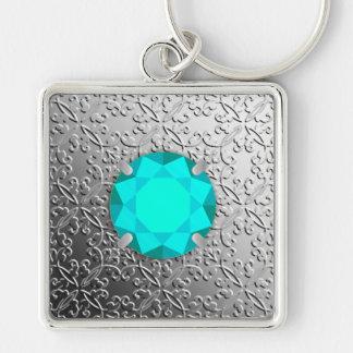 Silver Damask with a faux aquamarine gemstone Keychain