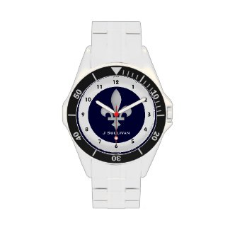 This classic stainless steel watch features a silver fleur-de-lis on a background of dark blue with black numbers on a circumference of white showing the time. Personalize with your name
