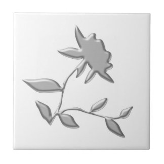 Silver Flower on a white tile