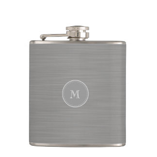 silver gray brushed metal texture and monogram flask
