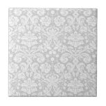 """Silver gray damask pattern ceramic tile<br><div class=""""desc"""">silver,  gray,  grey,   white,  pastel,  fancy,  damask,  pattern,  floral,  french,  swirly,  swirling,  flowery,   flowers,  flower,  leaves,  victorian,  vintage,  classy,  classic,  pretty,  feminine,  stylish,  elegant,  sophisticated,  fashionable,  patterned,  chic,  damasks,  shabby chic,  glamorous,  girly,  trendy,  wallpaper</div>"""