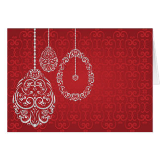 Silver hanging Easter eggs against a rich red back Card