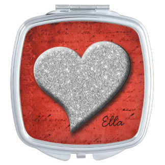 Silver heart on vintage red makeup mirrors