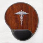 "Silver Like Caduceus Medical Symbol Mahogany Print Gel Mouse Pad<br><div class=""desc"">The Symbolic Silver Like Caduceus Medical Symbol design presented here on a mahogany wood grain printed background. The caduceus snakes is designed to look like it is made of chrome. Good for a graduation occasion, a statement for your profession, or for a gift with that medical look your are looking...</div>"