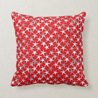 Silver stars on dark red throw pillow