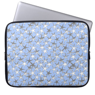 Silver stars, on pale blue laptop computer sleeves