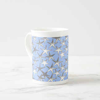 Silver stars, on pale blue tea cup