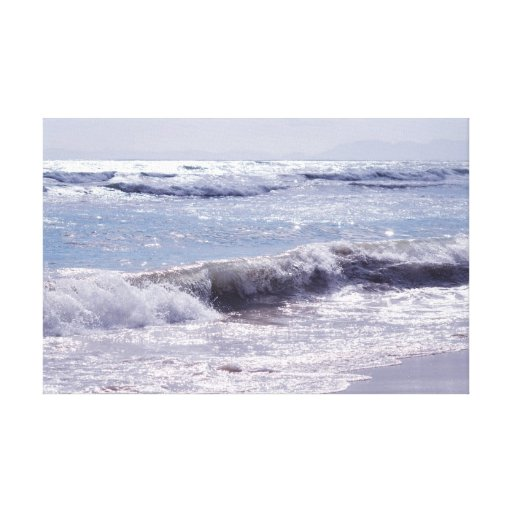 Silver waves breaking on the beach canvas prints