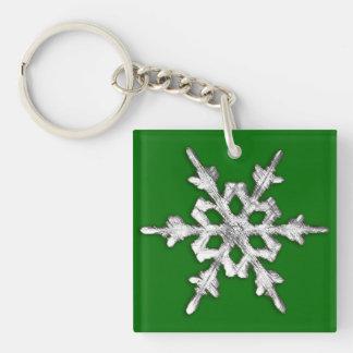 Silver & white snowflake on pine green keychain