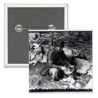 Silversmith at work, c.1914 button