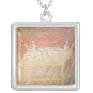 Silverware on a table silver plated necklace