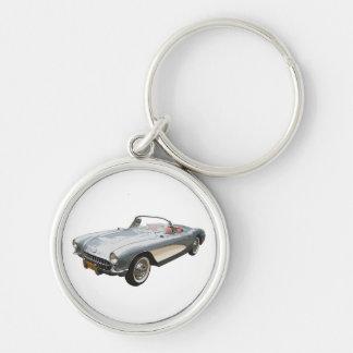 Silvery blue 1959 Corvette on white key chain.